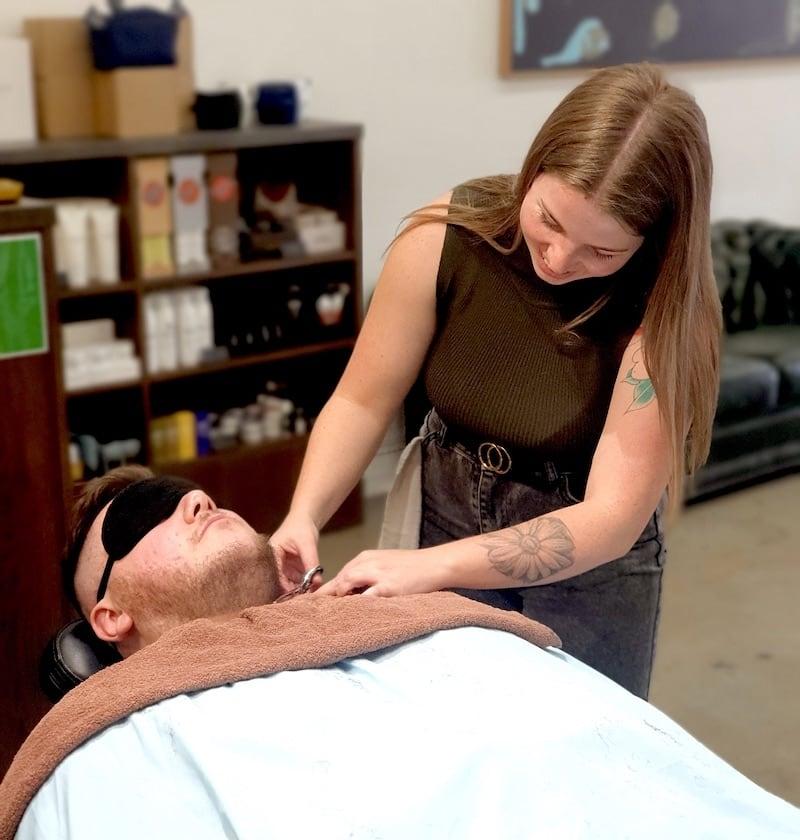 Female barber working in a barbershop in Melbourne